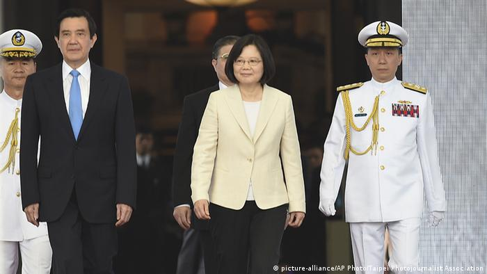 Taiwan President Ma Ying-jeou, left, Taiwan's new president Tsai Ing-wen, center
