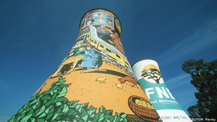 A former cooling tower of a coal fired power station is now painted with brightly colored murals.
