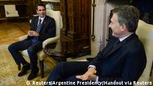 13.06.2016+++ Argentina's President Mauricio Macri (R) talks with Venezuelan opposition leader and Miranda state governor Henrique Capriles at the Casa Rosada goverment house in Buenos Aires, Argentina, June 13, 2016. REUTERS/Argentine Presidency/Handout via Reuters ATTENTION EDITORS - THIS IMAGE WAS PROVIDED BY A THIRD PARTY. EDITORIAL USE ONLY. (c) Reuters/Argentine Presidency/Handout via Reuters