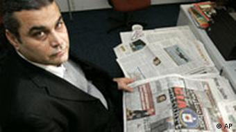 Khaled el-Masri with newspapers