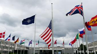 A US flag waves at half mast in front of NATO headquarters in Brussels