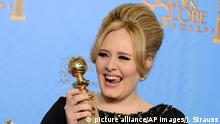 Adele poses with the award for best original song in a motion picture for Skyfall backstage at the 70th Annual Golden Globe Awards at the Beverly Hilton Hotel on Sunday Jan. 13, 2013, in Beverly Hills, Calif. (Photo by Jordan Strauss/Invision/AP) Copyright: picture alliance/AP Images/J. Strauss