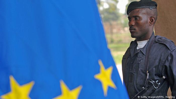 An African soldier standing next to the EU flag (C) Getty Images/AFP/L. Healing