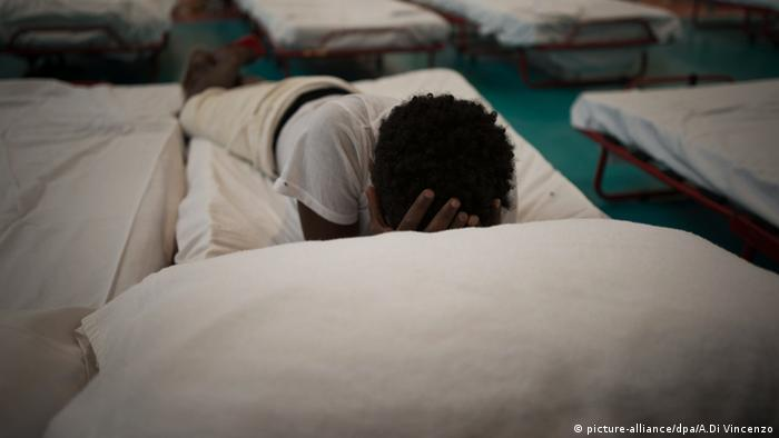 A migrant child at a refugee shelter in Italy