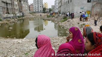 Fellow garment workers at the site of the Rana Plaza building to mark the second anniversary of the building's collapse in 2015