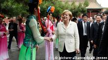 Angela Merkel Museu m Kaiserpalast in Shenyang China