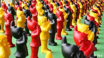 Rows of black, yellow and red dwarves are part of the installation Geheimnisträger at the art Karlsruhe art fair