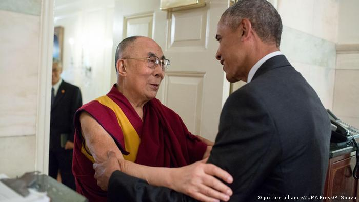 US President Barack Obama embraces His Holiness the Dalai Lama at the entrance of the Map Room of the White House June 15, 2016.