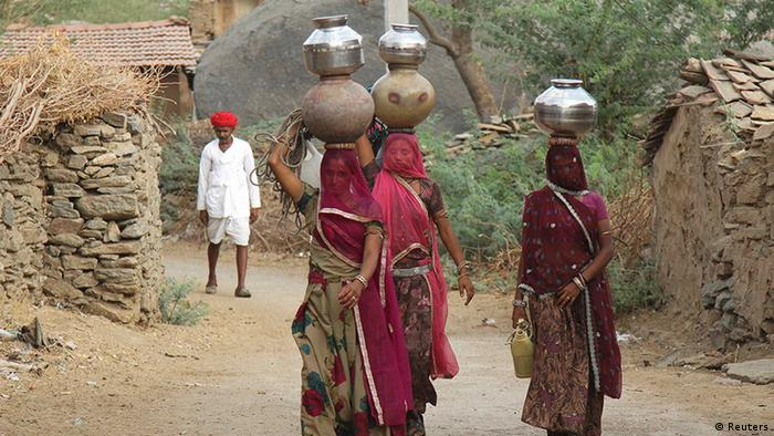 Women in Rajasthan, India, carrying water jugs