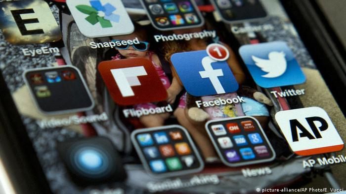 A view of an iPhone in showing Facebook and Twitter apps among others