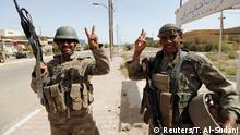 17.06.2016+++ Iraqi soldiers gesture in center of Falluja, Iraq, June 17, 2016. +++ (C) Reuters/T. Al-Sudani