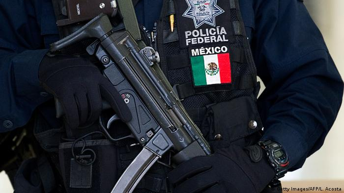 Armed Mexican police officer