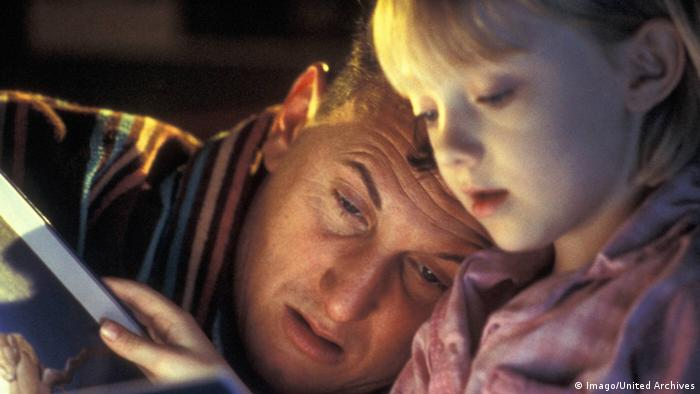 'I am Sam' film still shows daughter reading to dad (Copyright: Imago/United Archives)