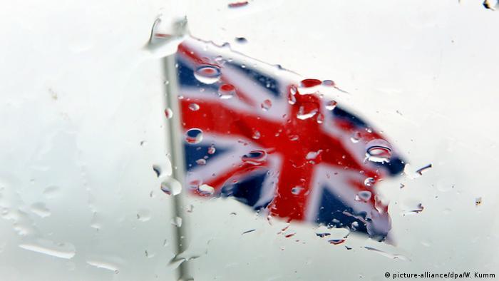 Union flag seen through rain drops on window