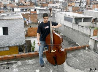 Bassist Adriano Costa Chaves rehearses on the roof of his house in Heliopolis, the largest shantytown in Sao Paulo, Brazil, on Saturday, March 11, 2006. Chaves is a musician of the Baccarelli Institute, a nonprofit organization that uses classical music to help slum youths. Famed conductor Zubin Mehta was so impressed by Chaves' rendition of Domenico Dragonetti's Solo for Double Bass that he offered the youth a scholarship to study in Tel Aviv at a music academy linked to the philharmonic orchestra. (AP Photo/Andre Penner)