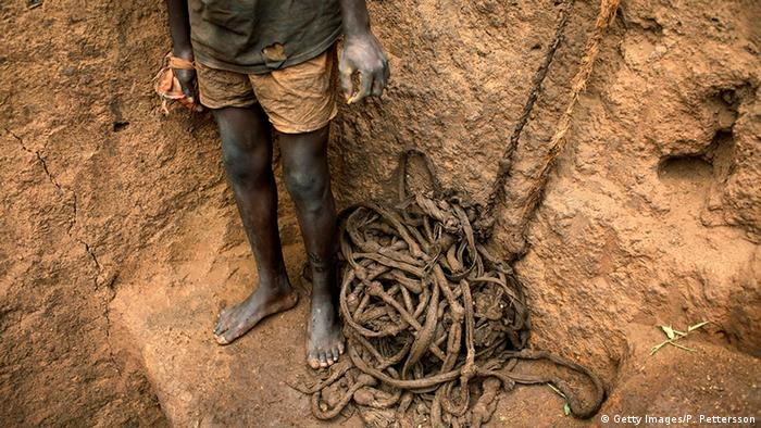A young boy inside a cobalt mine in DRC. (Getty Images/P. Pettersson)