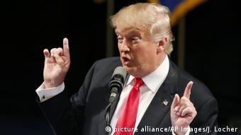 Republican presidential candidate Donald Trump gestures with both hands during a speech at the Treasure Island hotel and casino in Las Vegas.
