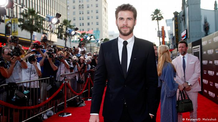 Actor Liam Hemsworth on the read carpet, (c) Reuters/D. Moloshok