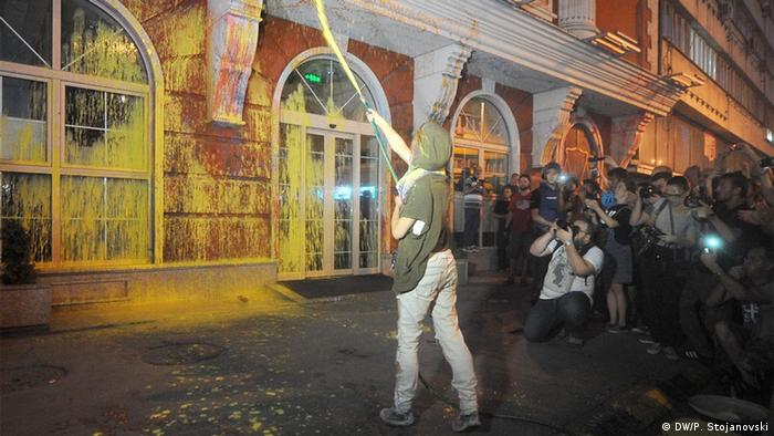Protestors spray paint on government party buildings in Skopje
