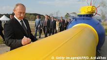 Russia's Prime Minister Vladimir Putin signs an autograph on a natural gas pipeline Sakhalin-Khabarovsk-Vladivostok in the Russian Far East city of Vladivostok on September 8, 2011, during the pipeline's launch ceremony. +++ (C) Getty Images/AFP/D. Astakhov