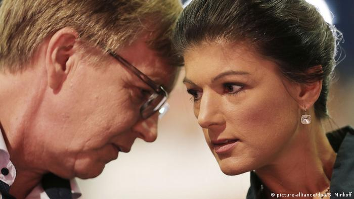 Left Party leaders Sahra Wagenknecht und Dietmar Bartsch lean their heads together to discuss something quietly during a meeting of parliament