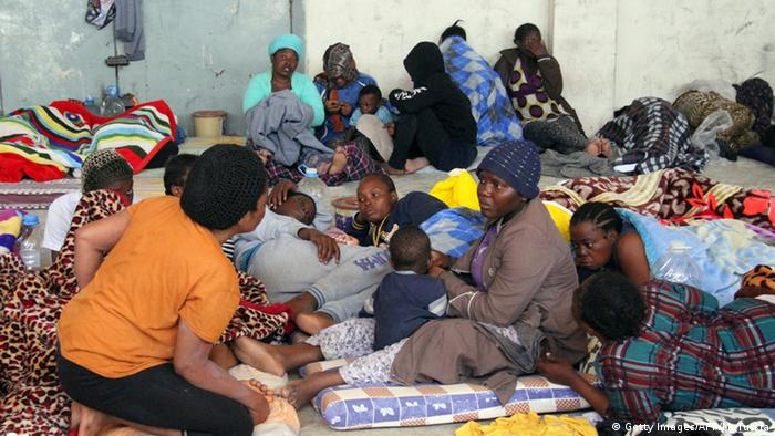 A group of illegal African migrants sitting in a shelter in Libya Copyright: Getty Images/AFP/M. Turkia