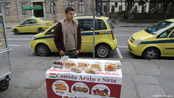 Mohammed Razak, a Kurd from northern Syria, sells Arab street food in Catete, in the South Zone of Rio