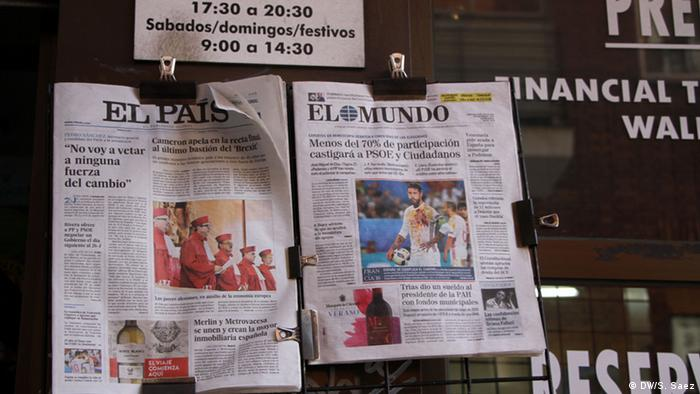 Newspapers at a news stand in Madrid