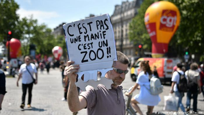 Some of the participants criticized the rally, with one holding a sign saying: This is not a protest, it is a zoo.