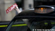 A taxi driver holds a sticker for the Vote Leave pro-Brexit campaign as he drives past media in central London on June 22, 2016, ahead of the June 23 EU referendum. Rival sides threw their efforts into the final day of campaigning Wednesday, on the eve of Britain's vote on EU membership that will shape the future of Europe. / AFP / JUSTIN TALLIS (Photo credit should read JUSTIN TALLIS/AFP/Getty Images) © Getty Images/J.Tallis