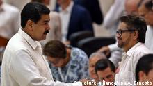 El presidente de Venezuela, Nicolás Maduro, y el el exjefe negociador de paz Iván Márquez