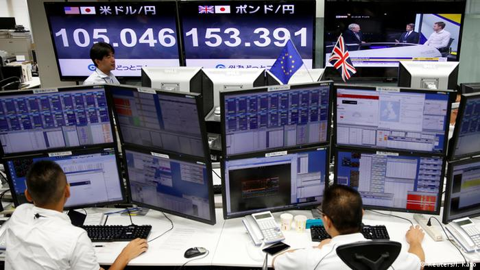 Traders work in front of monitors displaying TV news on Britain's EU referendum and the Japanese yen's exchange rate against British pound and the U.S. dollar in Tokyo.