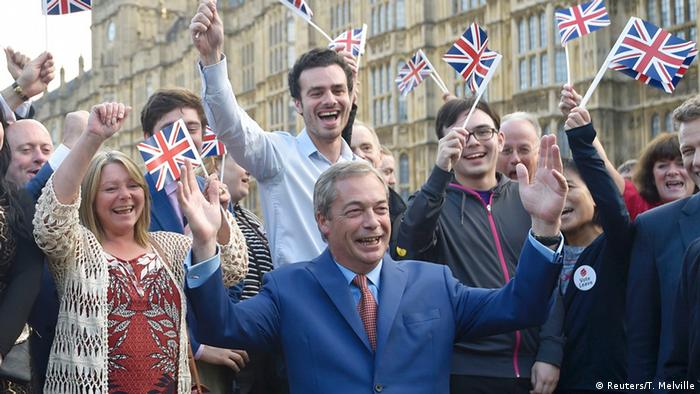 Nigel Farage seen amid a group of flag-waving Brexit supporters (Reuters/T. Melville)
