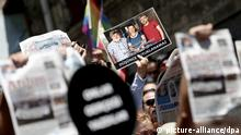 Protesters call for the release of the three journalists