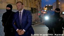 24.6.2016*** Kirov Region Governor Nikita Belykh (C), is escorted to the Basmanny district court to attend his hearing in Moscow on June 24, 2016. The governor of Russia's central Kirov region was arrested Friday allegedly in the act of accepting a bribe of 400,000 euros ($447,000), the Russian committee of enquiry said. Belykh is suspected of accepting the money, through an intermediary, in return for turning a blind eye to dodgy investments in the region. / AFP / VASILY MAXIMOV (Photo credit should read VASILY MAXIMOV/AFP/Getty Images) Getty Images/AFP/V. Maximov