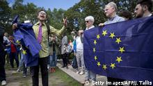 June 25, 2016 Demonstrators hold EU flags as they protest against the outcome of the UK's June 23 referendum on the European Union (EU), in central London on June 25, 2016. The result of Britain's June 23 referendum vote to leave the European Union (EU) has pitted parents against children, cities against rural areas, north against south and university graduates against those with fewer qualifications. London, Scotland and Northern Ireland voted to remain in the EU but Wales and large swathes of England, particularly former industrial hubs in the north with many disaffected workers, backed a Brexit. / AFP / JUSTIN TALLIS (c) Getty Images/AFP/J. Tallis