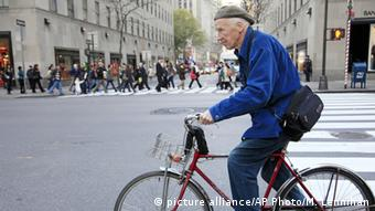 Bill Cunningham on his bike in New York