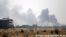 23.06.2016 *** Smoke rises from buildings in Fallujah as members of the Iraqi government forces clear the streets of city from road-side bombs and booby-traps on June 23, 2016. Lieutenant General Abdulwahab al-Saadi who is in charge of the Fallujah operation told AFP that more than 80 percent of the Fallujah is under the control of the Iraqi forces. / AFP / afp / HAIDAR MOHAMMED ALI (Photo credit should read HAIDAR MOHAMMED ALI/AFP/Getty Images) Copyright: Getty Images/AFP/H. M. Ali