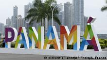 25.6.2016 *** Two police officers cycle past a Panama sign in Panama City, Saturday, June 25, 2016. The $5.25 billion expansion of the Panama canal is set to open Sunday. The expansion will also allow larger ships to pass, increasing efficiency. The renovations will double the canal's capacity, tap new markets such as liquid natural gas shipments and cut global maritime costs by an estimated $8 billion a year. (AP Photo/Arnulfo Franco) Copyright: picture-alliance/AP Photo/A. Franco