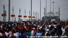 Thousands of spectators watch as the Panama flagged, COSCO Shipping Neopanamax cargo ship, prepares to cross the new new Agua Clara locks, part of the Panama Canal expansion project, near the port city of Colon, Panama, Sunday June 26, 2016. Authorities are hosting a big bash to inaugurate newly expanded locks that will double the Canal's capacity, as the country makes a multibillion-dollar bet on a bright economic future despite tough times for international shipping.. (AP Photo/Moises Castillo) | © picture-alliance/AP Photo/M. Castillo