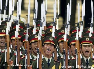 People's Liberation soldiers parade on the forecourt beside the Great Hall of the People on Beijing's Tiananmen Square