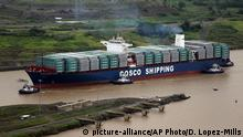 The COSCO Shipping Panama cargo ship prepares to cruise past the old Pedro Miguel locks, as it heads towards the new Cocoli locks, part of the new Panama Canal expansion project, in Panama City, Sunday June 26, 2016. Authorities are hosting a big bash to inaugurate newly expanded locks that will double the Canal's capacity, as the country makes a multibillion-dollar bet on a bright economic future despite tough times for international shipping. (AP Photo/Dario Lopez-Mills) | Copyright: picture-alliance/AP Photo/D. Lopez-Mills