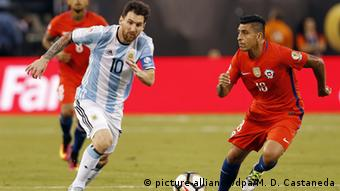 Lionel Messi (L) of Argentina fights for the ball with Gonzalo Jara (R) of Chile