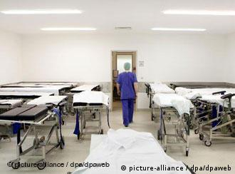 A doctor walking out of an empty ward