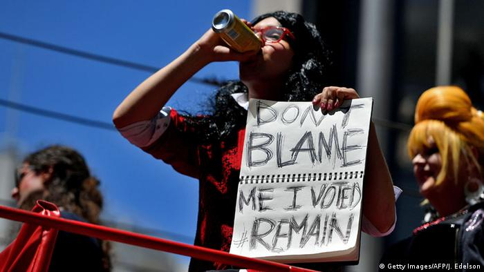 A person holds a sign that reads 'Don't blame me I voted #Remain'