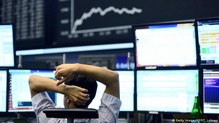 A trader sits at a desk in the Frankfurt Stock Exchange (Getty Images/AFP/T. Lohnes)