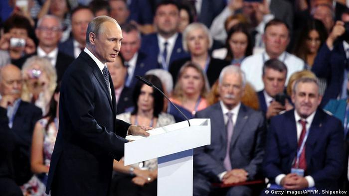 man addressing crowd (c) Getty Images/AFP/M. Shipenkov