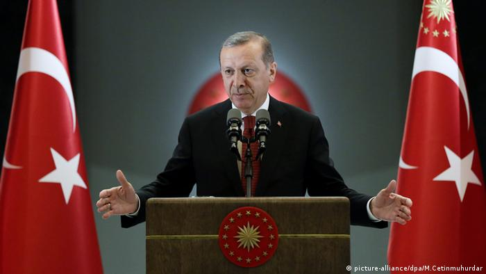 Turkish President Recep Tayyip Erdogan gestures during a press conference