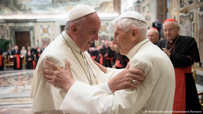 Former Pope Benedict is greeted by Pope Francis (Reuters/Handout/Osservatore Romano)