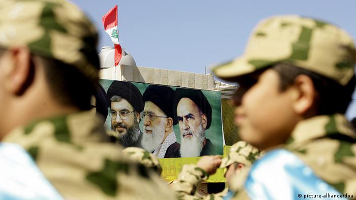 A poster shows Hezbollah leader Hassan Nasrallah, Iranian supreme leader Ayatollah Ali Khameinei and late Iranian supreme leader Ayatollah Khomeini in Lebanon in 2014